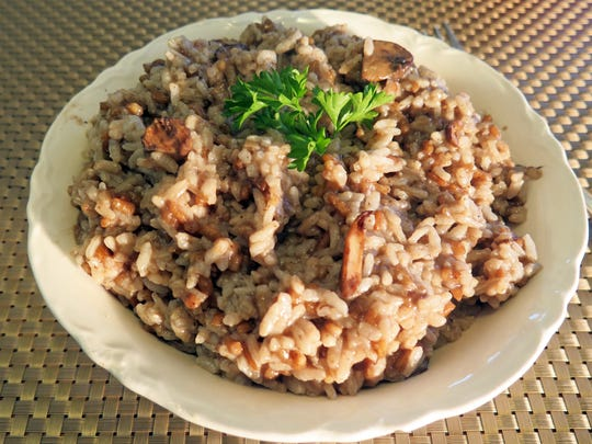 Black garlic lends a distinctive flavor to this mushroom risotto.