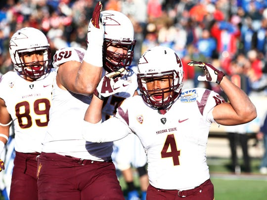 Arizona State's Demario Richard (4) celebrates after