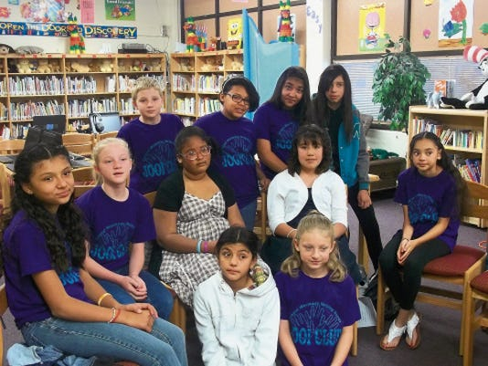 Central Elementary School Helping Hands JOOI Club members sport their club T-shirts at a meeting.