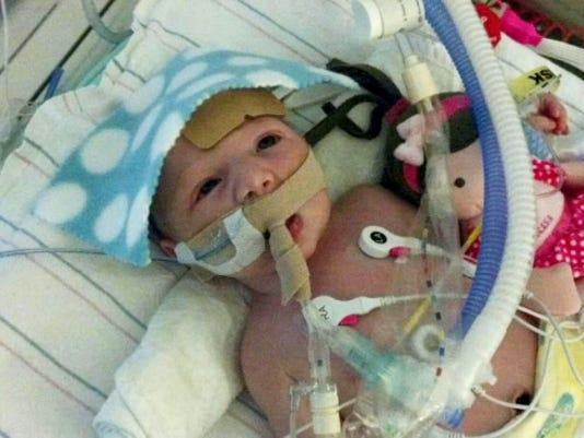 It was difficult for Heather Myers to see her weeks-old daughter, Olivia, hooked up to machines after an emergency open heart surgery, but another mother whose baby had just gone through the same procedure helped her and her husband to get through it.