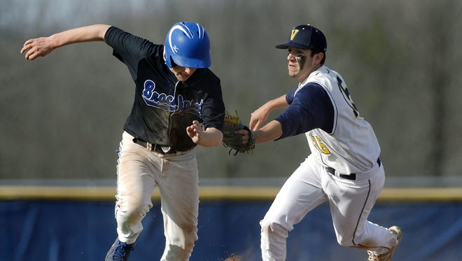 Victor's Ryan Simmons, right, tags Brockport's Riley Emmerson in a rundown at third base at Victor High School on Monday. Brockport beat Victor 5-3.