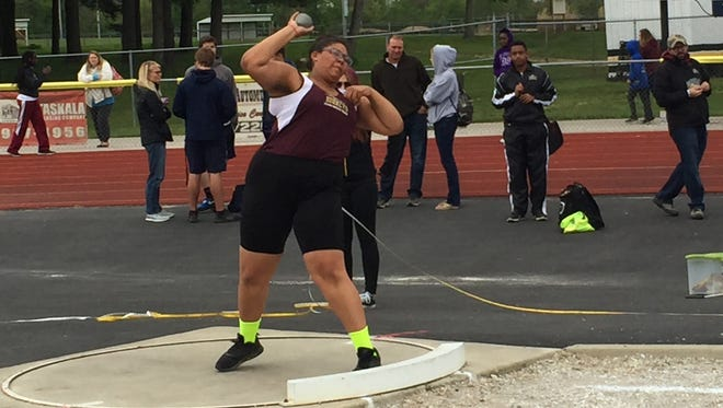 Licking Heights junior Cherokee Bodell competes in the shot put May 9 during the Licking County League Buckeye-Division championships.