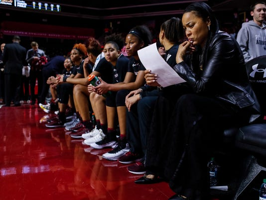 South Carolina's head coach Dawn Staley looks over the statistics sheet while sitting on the bench with her team after the first half of an NCAA college basketball game against Temple, Thursday, Dec. 21, 2017, in Philadelphia. (AP Photo/Chris Szagola)