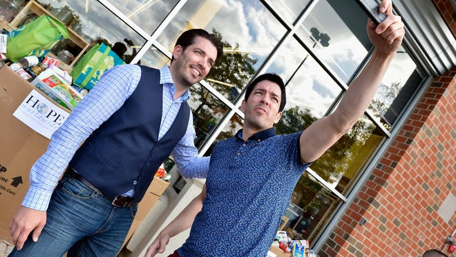 """Jonathan and Drew Scott, hosts of HGTV's """"Property Brothers,"""" celebrate the grand opening of store in Framingham, MA."""