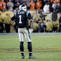 Carolina Panthers' Cam Newton stands on the field Sunday as the clock winds down at the end of Super Bowl 50.