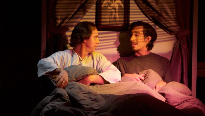 """In a scene from the Desert Rose Playhouse production of """"Angels in America,"""" Nick Edwards portrays Prior Walter and Daniel Gutierrez plays Louis."""