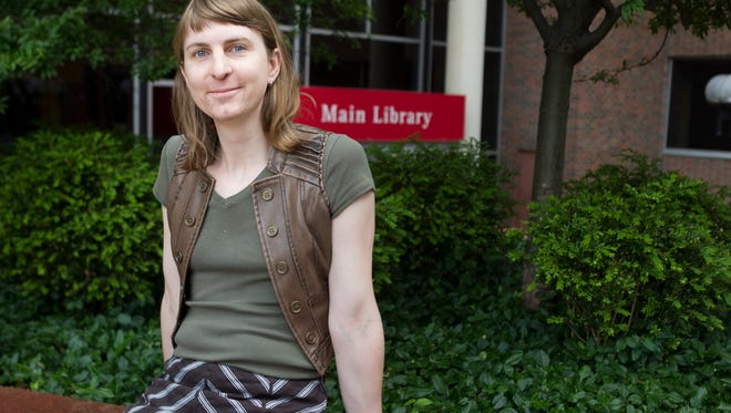 Rachel Dovel poses for a photo Wednesday, May 10, 2017 in front of the Public Library of Cincinnati. Dovel recently won a lawsuit against the library.