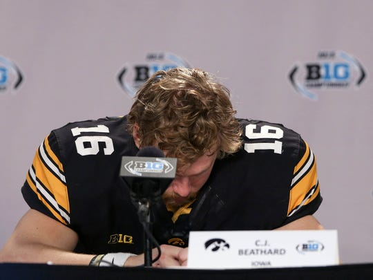 Iowa Hawkeyes quarterback C.J. Beathard (16) reacts during a press conference following Saturday's 16-13 loss to Michigan State in the Big Ten Conference championship game.