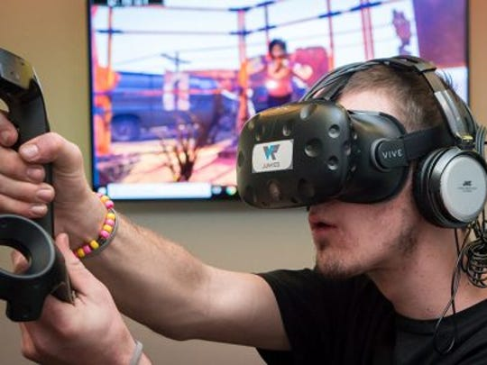 Tyler Powell, who visited VR Junkies in Tempe for the first time, got to play games in virtual reality that he had only played on a personal computer before.