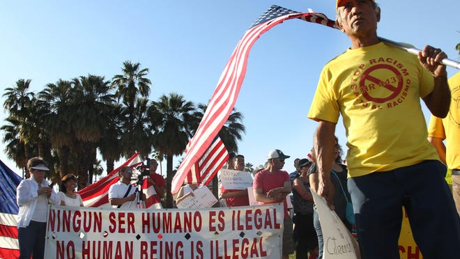 Filamon Rosales, a member of Comite Latino, an immigrant rights support group, participates in a May Day march at Frances Stevens Park in Palm Springs, California as part of a national day of marches around the U.S. to gather support for immigration reform.