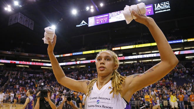 The Mercury's  Brittney Griner celebrates following their 85-78 win over the San Antonio Stars in their WNBA game Tuesday, June 30. 2015  in Phoenix.
