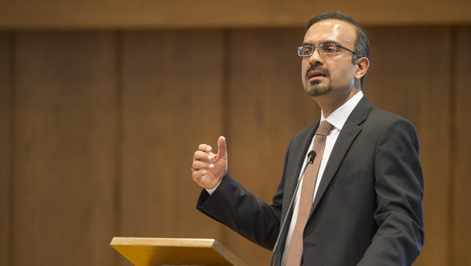 Muzaffar Ahmab, spokesman for the Ahmadiyya Muslim Community of Indiana, spoke at an event Saturday at Faith Presbyterian Church in Indianapolis about ISIS and the Muslim community.  Muzaffar Ahmad introduces the guest speaker to the stage. Faith Presbyterian Church and Ahmadiyya Muslim Community of Indiana hosted an event aimed at educating the public on the true meaning of Islamic teachings. The event featured guest speaker Dr. David Carlson, a professor of religious studies at Franklin College. Dr. Carlson explained how groups like the Islamic State are distorting the teachings of Islam to achieve their goals.