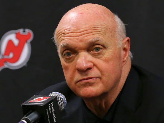 New Jersey Devils president and general manager Lou Lamoriello makes an announcement regarding the team's head coach during an NHL hockey news conference on Saturday, Dec. 27, 2014, in Newark, N.J. Devils are replacing the fired Pete DeBoer with a three-headed coaching staff. Former Washington Capitals coach Adam Oates, ex-Devils assistant and star defenseman Scott Stevens and Lamoriello will split duties on the bench. (AP Photo/Adam Hunger)