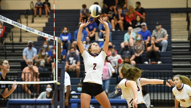 Bastrop's Briana Mutschink (2) sets the ball for a teammate.