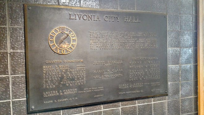 This plaque, which lists many of Livonia's founding leaders, is now back up at city hall.