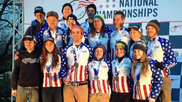The Brevard College Tornados celebrate on the podium after winning the Cyclo-Cross title in 2015.
