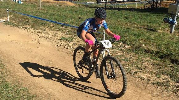 Alison Arensman fo Brevard College competes in the cross country race at the USA Cycling Collegiate Mountain Bike Championships.