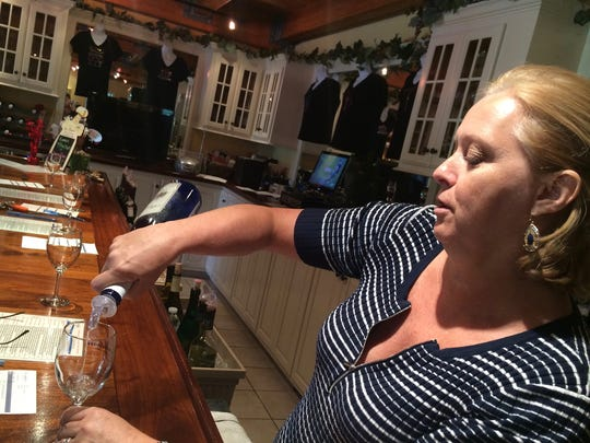 Lisa Shelton, who owns Bordeleau Winery with her husband, Tom, pours samples for guests. The winery offers 20 different kinds of wine, and the couple grows seven grape varieties on the property.
