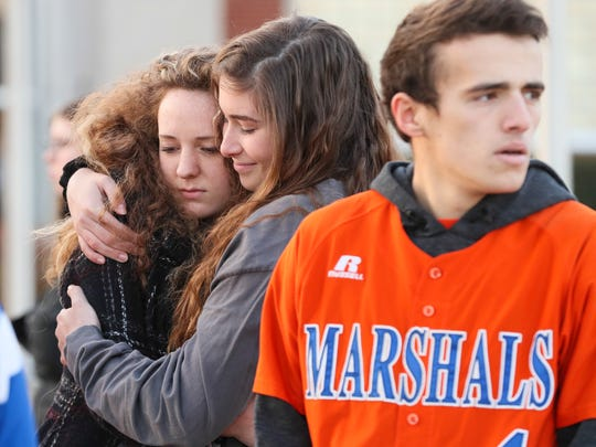 Two students hug after a prayer circle at Paducah Tilghman High School on Wednesday morning.