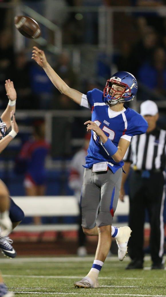 Carmel quarterback Payton Cayea (12) throws a pass