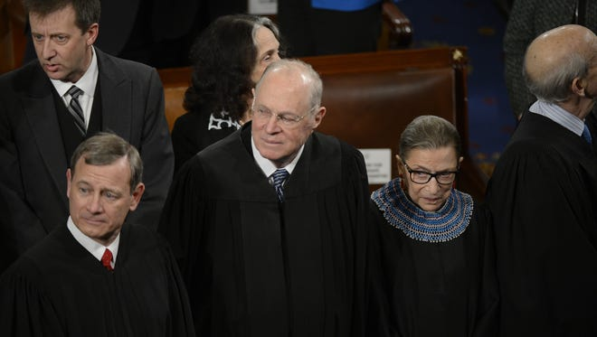 Chief Justice John Roberts, left, and Associate Justice Anthony Kennedy challenged an Indian tribe's right to try a non-member in tribal court.