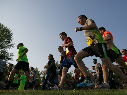 More than 10,000 runners take off from the starting line at the J.P. Morgan Chase Corporate Challenge on the campus of RIT on Tuesday, May 24, 2016.
