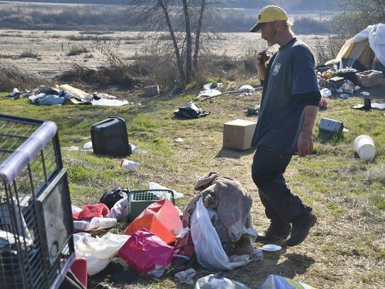 Ryan Cory packs up his belongings Tuesday afternoon