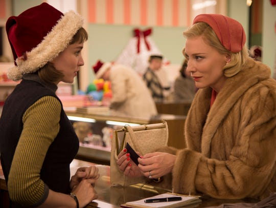 "Therese (Rooney Mara, left) and Carol (Cate Blanchett) meet in a department store in ""Carol."""