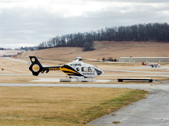 STAT MedEvac waits for a call on a pad at York Airport in Jackson Township. In the background is one of the hills that surround the airport, contributing to colder temperatures.