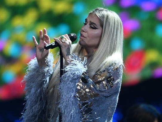 "Kesha performs on stage during the ""Elton John: I'm"