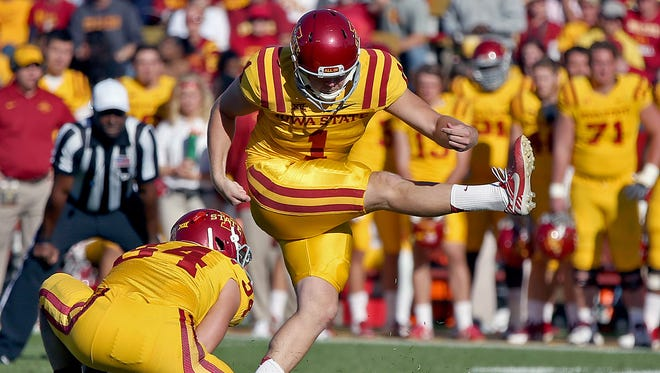 Iowa State's #34 Austin Fischer was the holder as #1 Cole Netten kicked his team's third field goal of the game near the end of the first half against Toledo  during a game at Jack Trice Stadium in Ames on Saturday  Oct. 11, 2014.