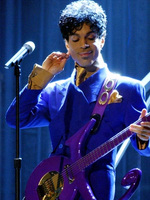 """Prince performs """"Purple Rain"""" as the opening act during the 46th Annual Grammy Awards show on Feb. 8, 2004 at the Staples Center in Los Angeles.  Prince died on April 21, 2016. He was 57. (Richard Hartog/Los Angeles Times/TNS)"""
