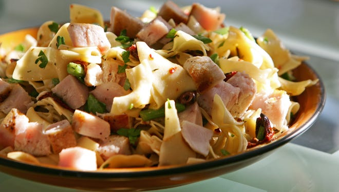 Robin Miller has created Tuna Nicoise with Egg Noodles, Sun Dried Tomatoes and Olives.