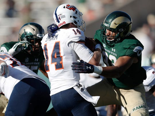 Colorado State linebacker Kevin Davis, right, sacks UTSA quarterback Dalton Sturm late in the second half of an NCAA college football game Saturday, Sept. 10, 2016, in Fort Collins, Colo. (AP Photo/David Zalubowski)