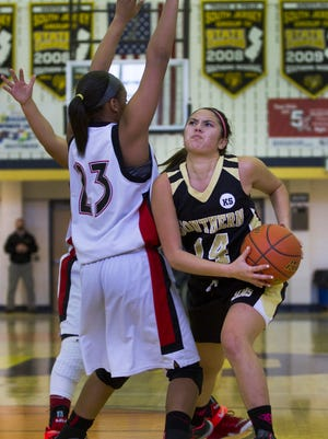 Southern Regional's Bianca Nicolini drives in to the basket against Neptune's Drianna Love. Neptune vs Southern Regional girls basketball in the Score at the Shore Girls Basketball final.