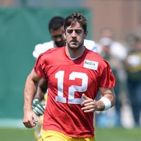 Green Bay Packers quarterback Aaron Rodgers jogs during organized team activities Thursday at Clarke Hinkle Field.