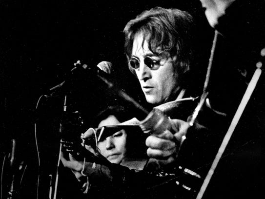 "John Lennon and Yoko Ono play the ""John Sinclair Freedom Rally"" in Ann Arbor in 1971."