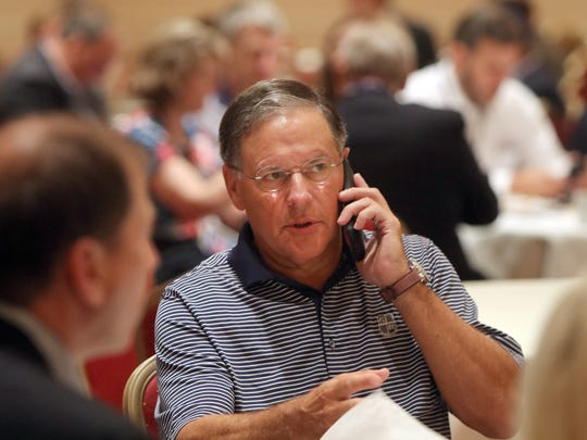 State Assemblyman Jon Bramnick (R-Union) takes a call before the New Jersey delegation breakfast at the Doubletree Hotel in Beachwood, OH, Monday July 16, 2016.