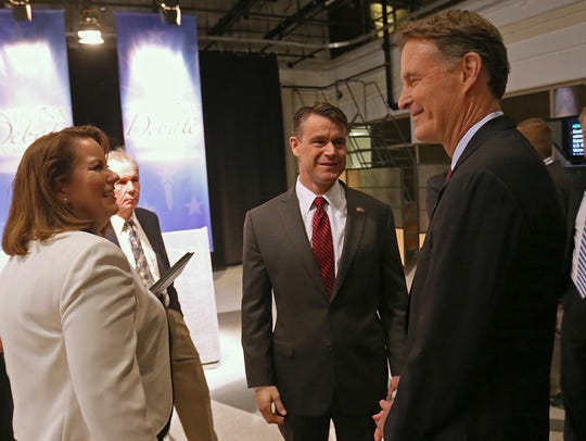The candidates mingle before the U.S. Senate debate