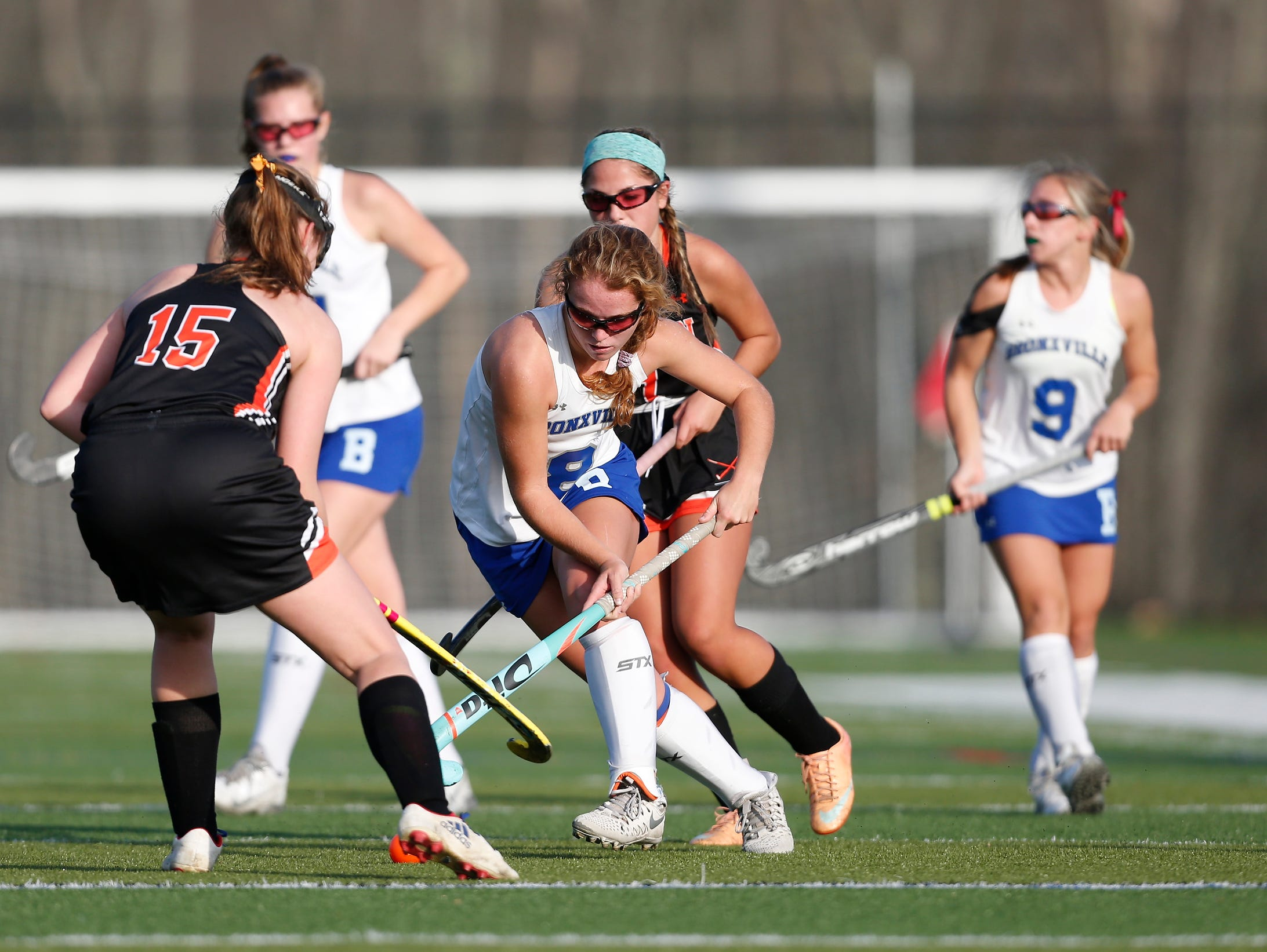 Bronxville's Ellie Walsh (8) works the ball past Croton's Emily Kehoe (15) during their 7-1 win in the Class C field hockey sectiion finals at Brewster High School on Tuesday, November 1, 2016.