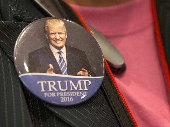 Billie Sumner wears a Trump button during the Indiana Republican watch party at the J.W. Marriott, Indianapolis, Tuesday, November 8, 2016.