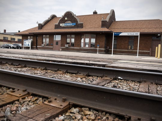 Amtrak signs are posted outside the depot building along the track Monday, April 24, in St. Cloud.