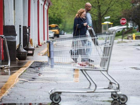 Customers exit the Marsh Supermarket on Hoyt Avenue