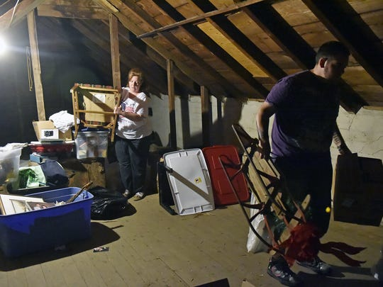 Amy Edwards and her son Tyler Edwards work to clean out her Red Lion attic on June 7, 2017.
