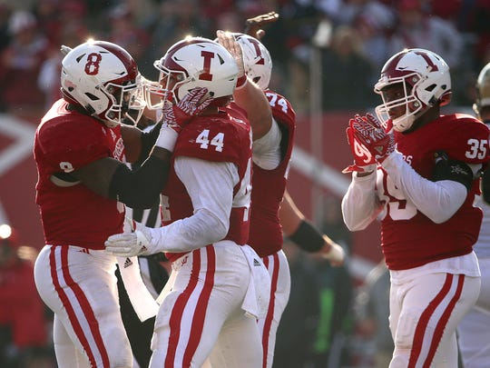 Marcus Oliver (44) was a two-time team captain and Indiana's all-time leader with 12 career forced fumbles. Last season Oliver celebrated with Tegray Scales (8)  after Oliver sacked Purdue Boilermakers quarterback David Blough in the Oaken Bucket game.