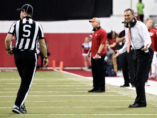 South Dakota head coach Bob Nielson argues a call to