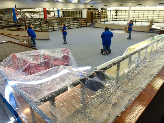 Workers prepare the media center at St. Cloud Apollo High School for summer remodeling work Tuesday, June 5, in St. Cloud.