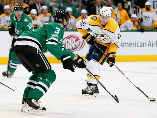 Dallas Stars defenseman John Klingberg (3) defends as Nashville Predators left wing Kevin Fiala (22) prepares to make a pass during the second period of an NHL hockey game Tuesday, Dec. 5, 2017, in Dallas. (AP Photo/Tony Gutierrez)