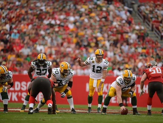 Green Bay Packers quarterback Aaron Rodgers gets ready