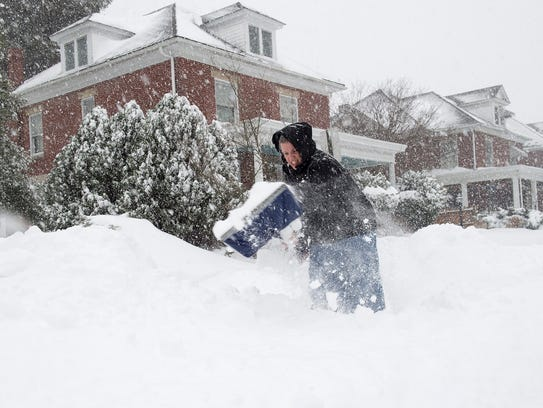 Kimberly Parlor shovels snow outside of her driveway